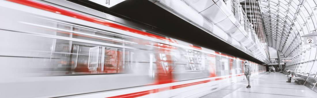 SAP App Center - A fast train passing through a station