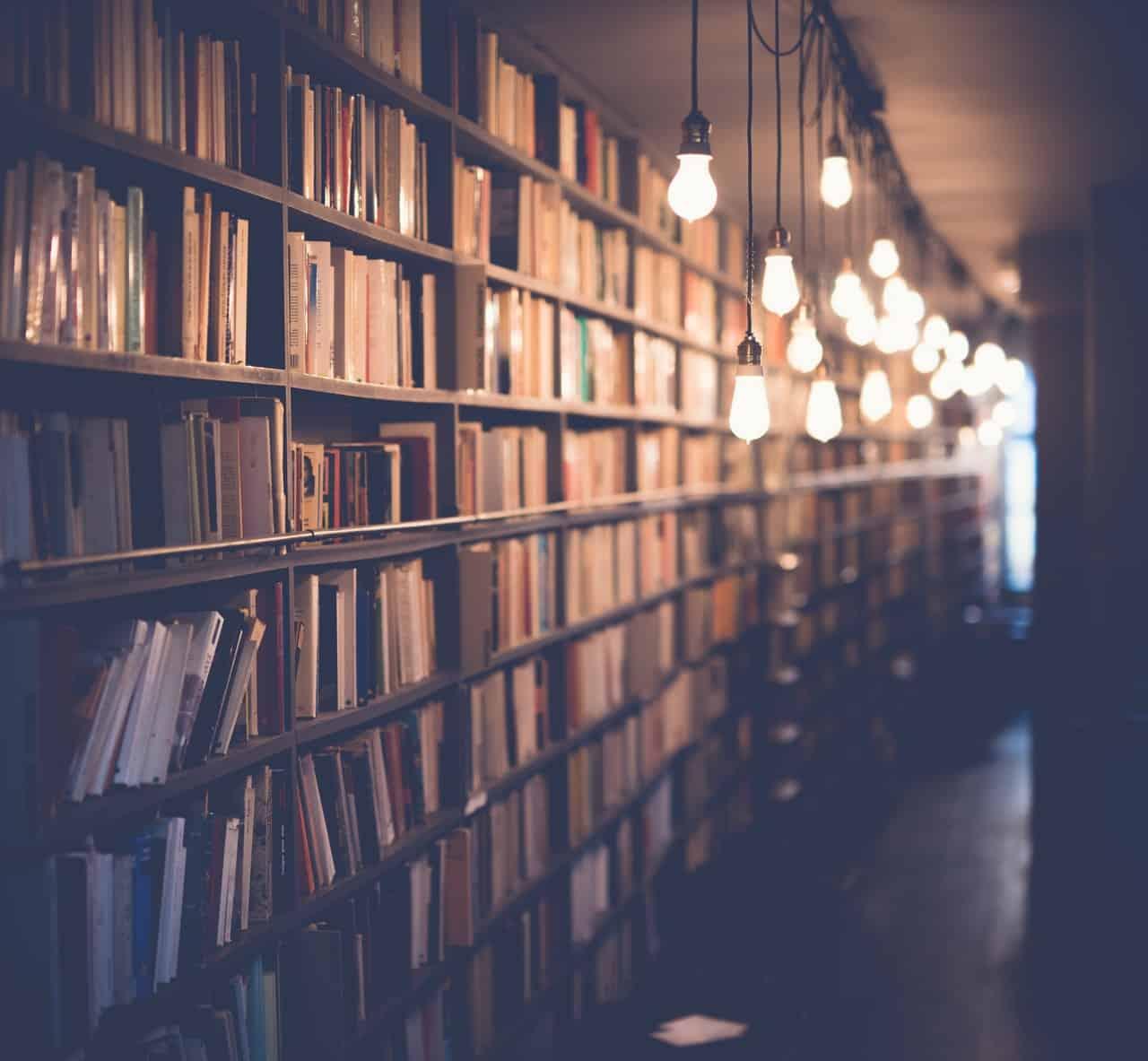 blur-book-stack-books-bookshelves