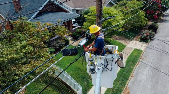 photography-of-man-repairing-electrical-wires